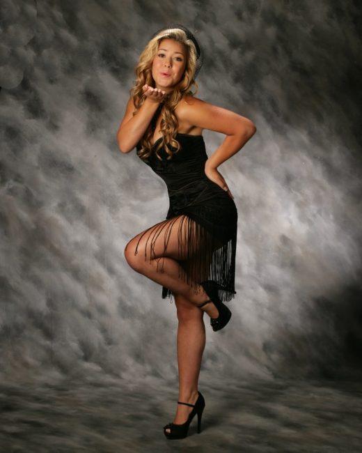 Wearing short black dress with long fringe
