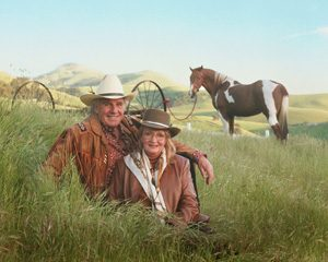 Couple in western dress with horse