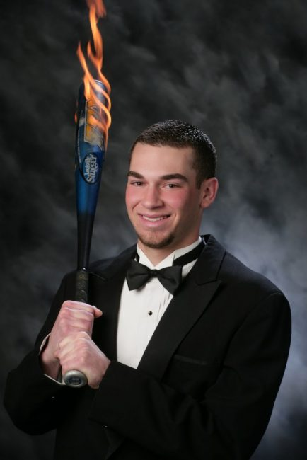 in tux with flaming bat