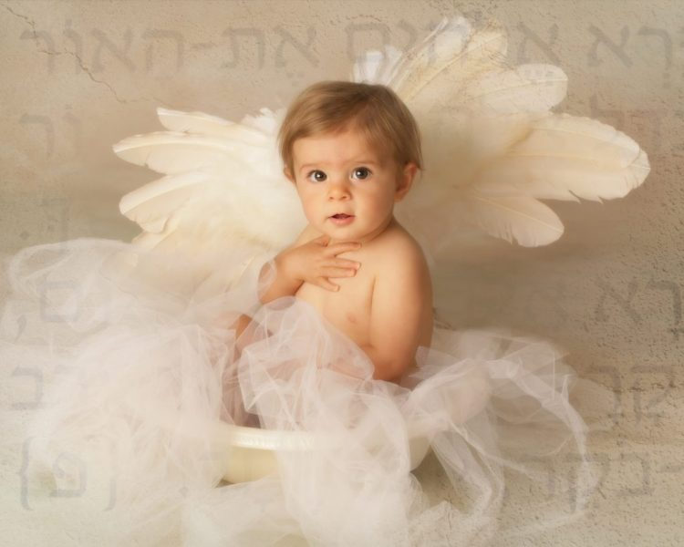 Baby as angel, with background of Hebrew letters
