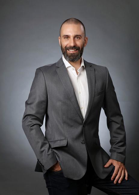 Professional portrait, wearing business suit